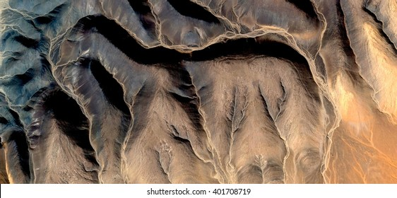 Allegory of stone picture of Afghan dog,  abstract photography of the deserts of Africa from the air, bird's eye view, abstract expressionism, contemporary art, optical illusions,