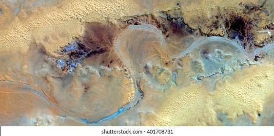Allegory of turquoise river yellowed, abstract photography of the deserts of Africa from the air, bird's eye view, abstract expressionism, contemporary art, optical illusions,