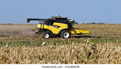 Allen, Kansas, USA, September, 26, 2014 Farmer uses a New Holland CR960 combine to harvest his corn field.  The combine harvester, or simply combine, is a machine that harvests grain crops.