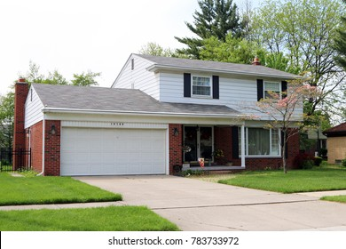 ALLEN PARK, MICHIGAN-DECEMBER 30, 2017:  Typical 1960's era home.  These homes typically had 3-4 bedrooms, attached garage and were on a well landscaped street.