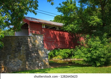 Allentown, PA, USA - July 10, 2011: The Wehr Covered Bridge is a historic wooden structure located in South Whitehall Township, Lehigh County, Pennsylvania. It spans the Jordan Creek.