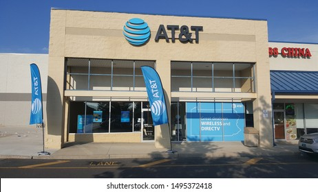 ALLENTOWN, PENNSYLVANIA, US - August 17, 2019: AT&T retail locations like this one in a shopping plaza in Allentown have introduced flags and offers for DirectTV to compete with rivals.