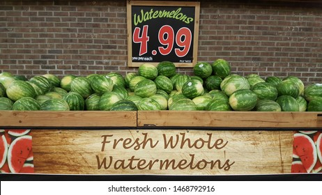 ALLENTOWN, PENNSYLVANIA, US - May 12, 2019: Watermelons like these at an Allentown Wegmans supermarket herald the approach of summer.
