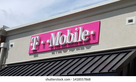 ALLENTOWN, PENNSYLVANIA, US - May 26, 2019: This T-Mobile logo on a retail outlet in Allentown has white letters on a pink background, an example of one way the carrier is trying to stand out.