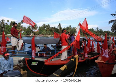 ALLEPPEY, INDIA - APR 21 : Volunteers of political parties in the backwater region campaign in boats for their candidate in the Indian general election on April 21, 2019 in Alleppey, Kerala,India