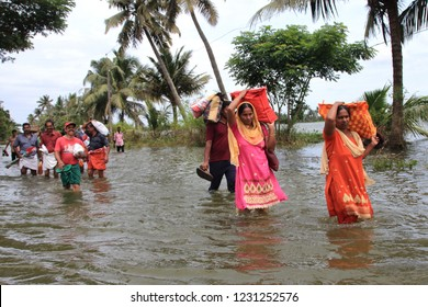 ALLEPPEY, INDIA - AUG 26: Unidentified people walk through the flood water on August 26,2018 in Alleppey, Kerala, India. Kerala was badly affected by the floods during the monsoon season.
