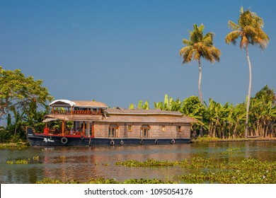 ALLEPPEY, INDIA -DECEMBER 20, 2013 : A house boat transports tourists around the backwaters  in Alleppey, India. House boat cruise is the top attraction of the inbound tourism in Kerala.