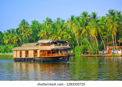 Alleppey, India - March 03, 2018: A house boat carrying tourists sailing on alleppey backwaters.