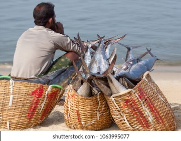 ALLEPPEY, INDIA - NOVEMBER 7, 2016: Indian fishermen selling fish on the morning fish market on the beach in Kerala, South India