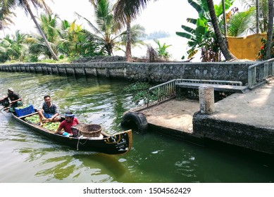 Alleppey Kerala, India 05 FEBRUARY 2018: three man on small wooden boat in river selling fruits at  Alappuzha city laccadive sea houseboat cruise backwaters, a network of tranquil canals and lagoons