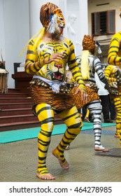 ALLEPPEY, KERALA, INDIA - 14 AUGUST 2010 : unidentified Body painted tiger dance artists perform on street of Alleppey, Kerala, India. Tiger dance is a traditional folk art performed during Onam.