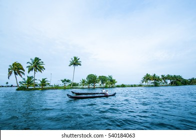 ALLEPPEY, KERALA, INDIA - 15 AUGUST 2010: Unidentified indian people in small boat in backwaters. Kerala backwaters are both major tourist attraction and integral part of local people life in Kerala