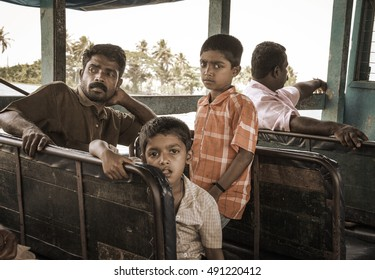 ALLEPPEY, KERALA, INDIA - 16 Feb 2016: Father with two sons rides on a regular boat in Alleppey, Kerala, India at 16 Feb. Mood in the vintage style.