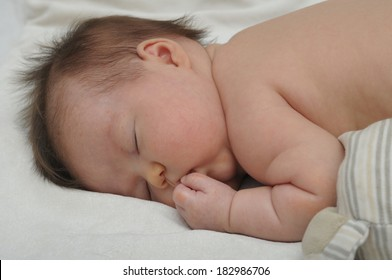 allergic eczema dermatitis sleeping baby portrait close up at night with open mouth, cute and adorable newborn baby face, baby skin care