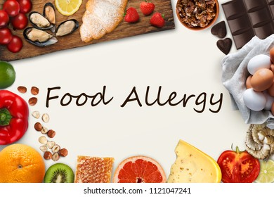 Allergic products collage. Set of allergy food, dairy, pastry, red vegetables and berries, citrus fruits, eggs, chocolate, nuts and seafood, isolated on white with black inscription, top view