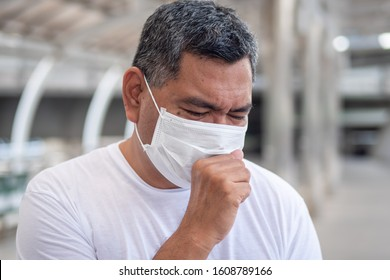 allergic sick old man coughing with sore throat; concept of man with allergy, sore throat or throat inflammation, influenza, flu, cold, sickness, health care, air pollution, polluted air  concept