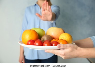 Allergy concept. Young woman refusing to eat fruits and vegetable