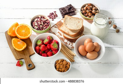 Allergy food concept. Allergic food on a white wooden background. Top view