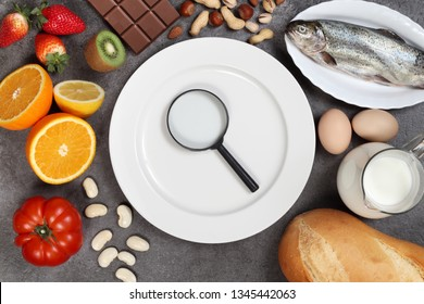 Allergy food concept. Foods, fruits, vegetables, empty plate on grey background
