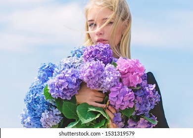 Allergy free life. Stop allergy blooming season. Girl tender blonde hold hydrangea bouquet. Springtime bloom. Pollen allergy. Female adore flowers. Spring attributes. Enjoy spring without allergy.