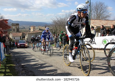 ALLEX, FRANCE - MAR 02: Thierry Hupond and Arnaud Courteille riding La Classic Drome UCI Europe Tour Pro Race on March 02, 2014 in Allex Hill, Drome, France. Romain Bardet won the race.