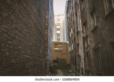An alley in a backyard of abandoned tenant house,  in Warsaw, Poland