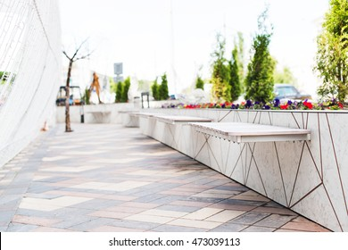 Alley with benches in a modern city, selective focus