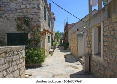 Alley between stone buildings in Croatia