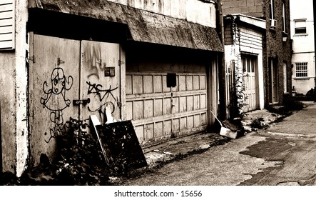 Alley garage entrance. Old Sepia look gives it more depth.