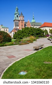 Alley and garden at the Wawel Cathedral in city of Krakow in Poland.