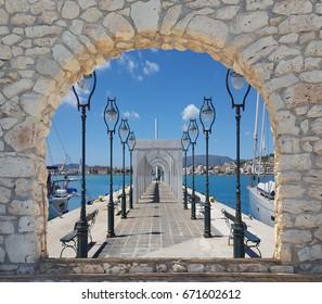 Alley with lanterns and arcades in Zante port on Zakynthos island, Greece