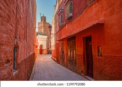 An alley and a minaret in the red medina of Marrakech, Morocco