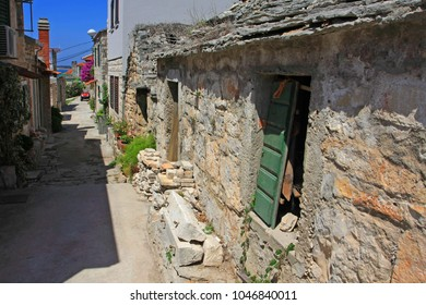 Alley with old stone houses in Croatian island Solta