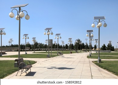 Alley in the park with a solar-powered lanterns
