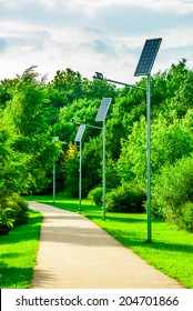 Alley in park with a solar-powered lanterns