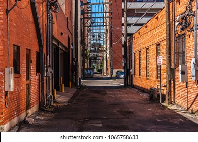 An alley with red brick buildings in Amarillo, Texas