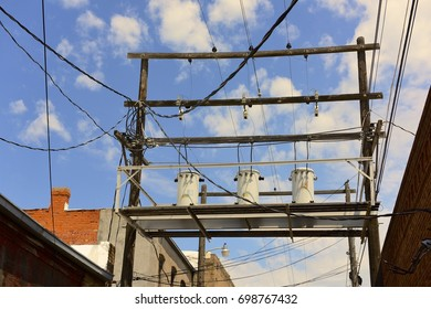 Alley with Rooftops and Electrical Wires and Transformers