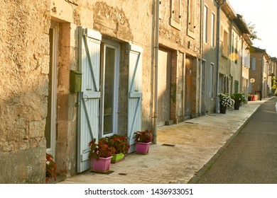 Alley and stone houses with clear shutters