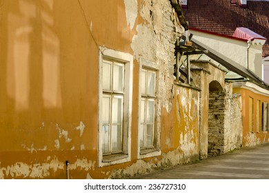 Alley in Tallinn, Estonia with withering walls.