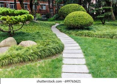 Alley in tropical garden, Beautiful Garden - Shutterstock ID 699763621