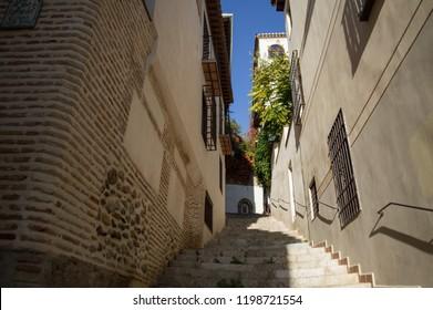 Alleyway with Carmen in Historic Center of Granada, Spain
