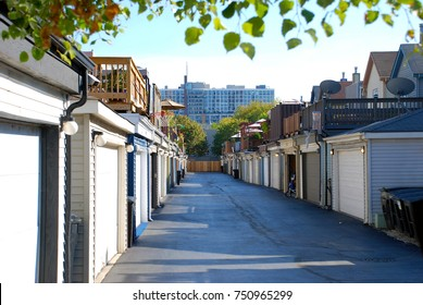 Alleyway of garages with decks/patios atop in Chicago