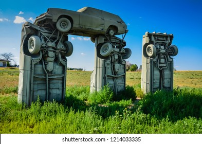 Alliance, NE /USA - July 15, 2013: Outdoor sculpture of painted gray cars, arranged to look like Stonehenge, in a Nebraska field. This is a popular roadside attraction in the middle of America.