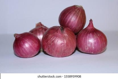 Alliumcepa,India red colour onion with white background.