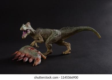 allosaurus with a stegosaurus body nearby on dark background