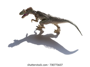 allosaurus toy on a white background with shadow