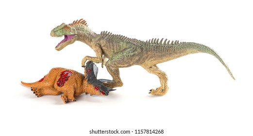 allosaurus with a triceratops body nearby on white background