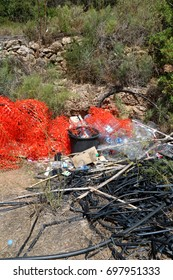 Allotment recycling 1: Color photograph of allotment rubbish, in the north of Ibiza, Spain.