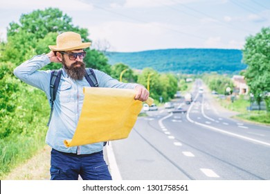 Allow recognize enough details to walk somewhere if get lost. I am lost on my way. Tourist backpacker map lost direction travelling. Around the world. Find direction map large sheet of paper.