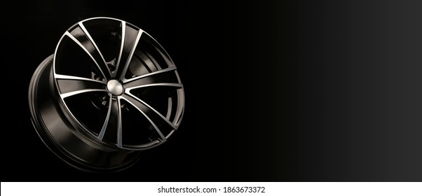 alloy wheel black with a white groove, 6 beams for SUVs and crossovers, close-up on a black background. panoramic layout for advertising a tire spare parts store, panorama.